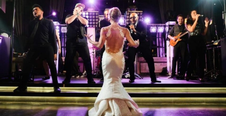 Austin Texas Live Wedding Band shown with bride dancing at the stage